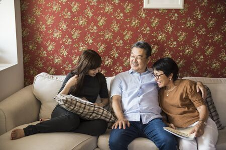 family  room: Asian family having fun in the living room together
