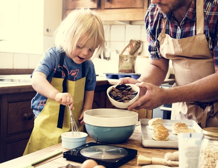 Boy baking with his father