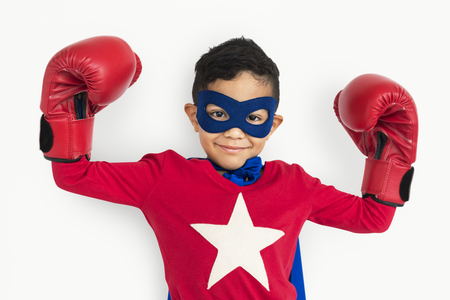 Boy in super hero costume with boxing gloves Stock Photo