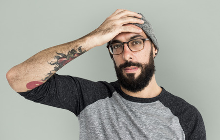 Bearded map with a beanie and glasses