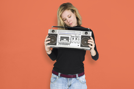 Woman holding a boombox