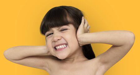 Little Girl Covering Ears Shoot Stock Photo