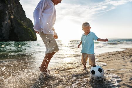 other keywords: Football Beach Playing Leisure Activity Fun Concept Stock Photo