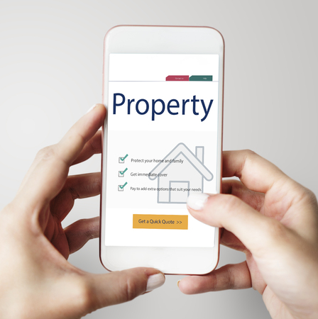 Mobile phone with property concept 免版税图像