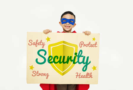 Boy in superhero costume with security concept Stock Photo