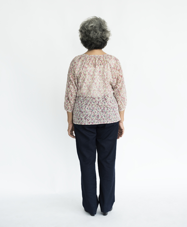 Old lady full body portrait rear view Stock Photo
