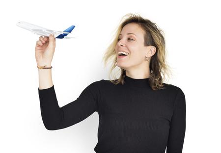 Woman holding a miniature plane Stock fotó