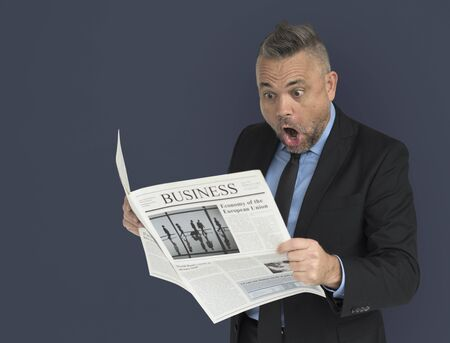 alarmed: Caucasian Business Man Reading Newspaper Shocked