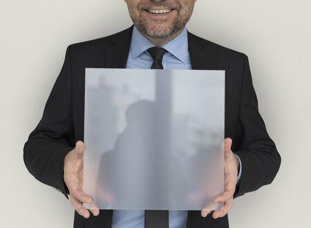 panel: Business Man Holding Panel Smiling
