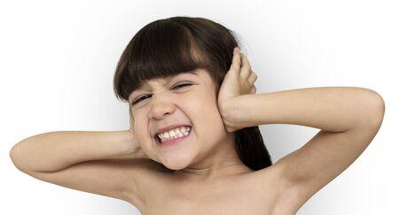 overwhelmed: Little Girl Covering Ears Shoot Stock Photo