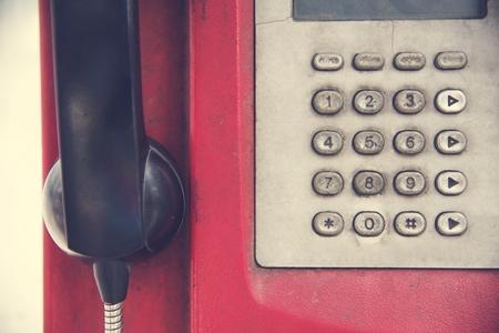 rundown: Old Rundown Red Payphone Stock Photo