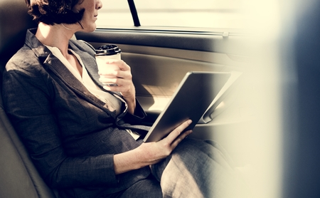 Businesswoman Using Tablet Car Inside Zdjęcie Seryjne