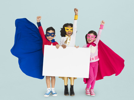 Superhero Kid Smiling Arms Raised Banner Copy Space Stock Photo
