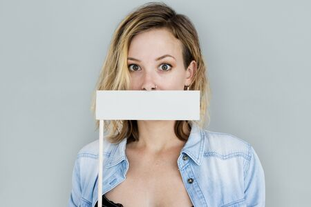censor: Caucasian Woman Holding Flag Covering Mouth