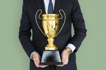 plaque: Business Man Holding Trophy Award