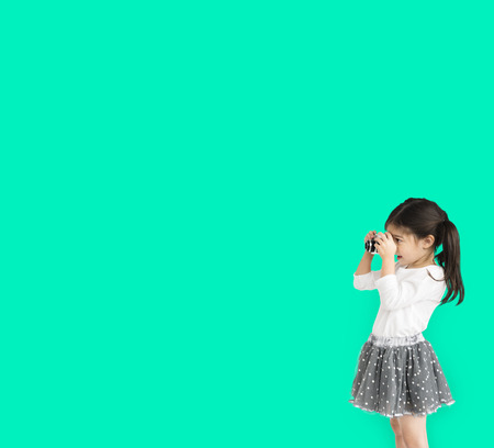 Little girl studio standing with binocular
