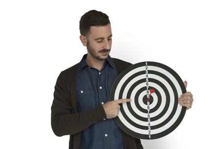 Man holding a dart board