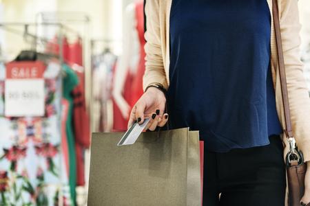 consumer: Young Woman Shopping Consumer Concept