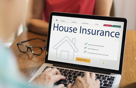 House insurance concept on laptop screen