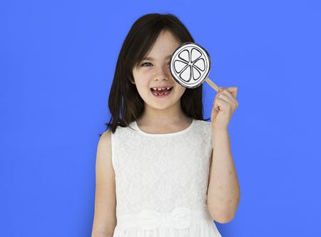 fake smile: Little Girl Smiling Lolipop Shoot