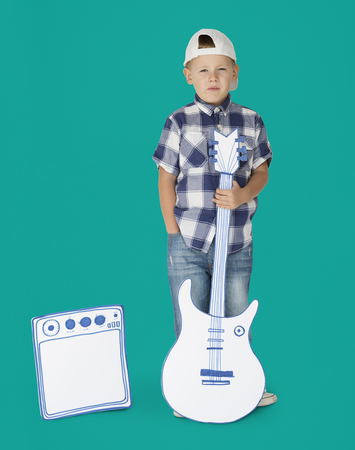 Portrait of a Little Blond Caucasian Boy with Guitar Isolated Stock Photo
