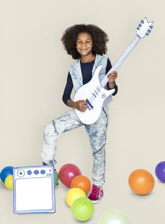 amp: Portrait of a Little African Descent Girl with a Guitar Isolated