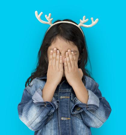 Little Girl Cover Eyes Wearing Reindeer Hairband