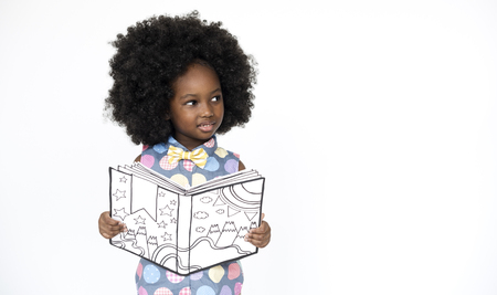 school: Little Girl Reading Book Education Togetherness Studio Portrait
