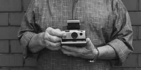 Person holding a retro instant camera 写真素材