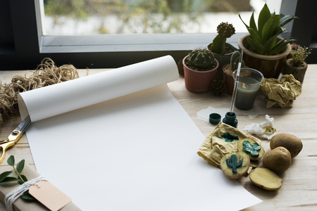 Painting Paper Cactus Plants On A Wooden Table