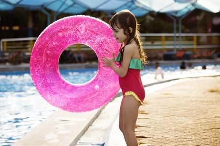 other keywords: Little Girl Holding Swimming Buoy Playful Pool Happiness