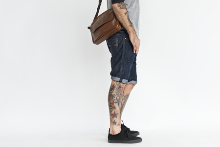 Cropped casual tattooed guy portrait