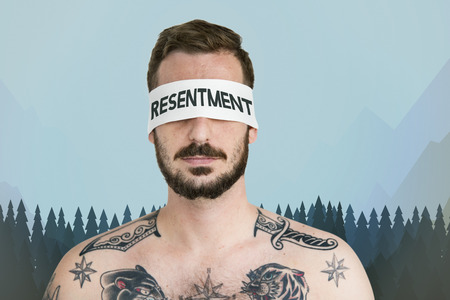 Resentment concept on blindfolded man