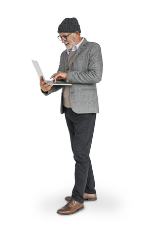 Senior man using a laptop concept