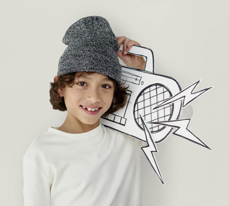 fake smile: Little Boy Holding Jukebox Smiling Papercraft