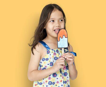 fake smile: Little Girl Eating Papercraft Icecream