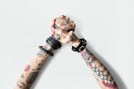 Hands with tattoos Foto de archivo - 112969269