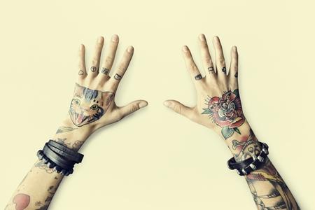Hands with tattoos Foto de archivo - 112969276