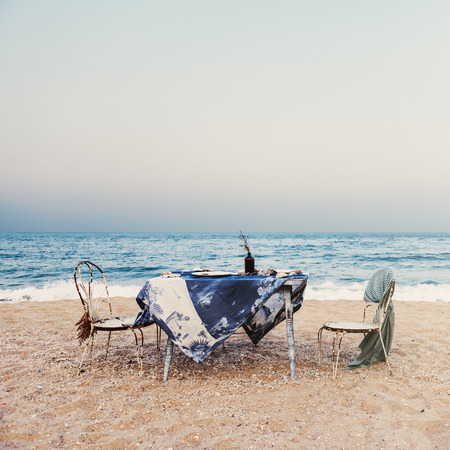 Table Chairs Meal Sea Shore Holiday Sky Concept Stock Photo