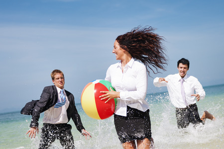 chasing: Business People Fun Playing Beach Travel Concept