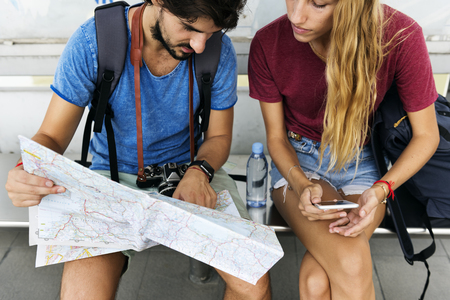 Couple traveling together with a map Stock Photo