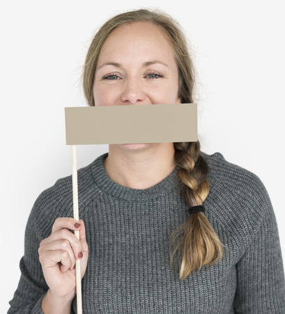 Caucasian Woman Holding Flag Covering Mouth