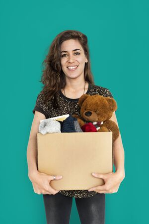 nosering: Woman Studio Portriat Casual Carrying a Box Isolated Stock Photo
