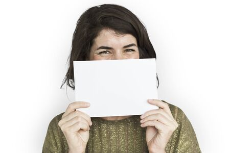 Woman holding up a blank card to her face