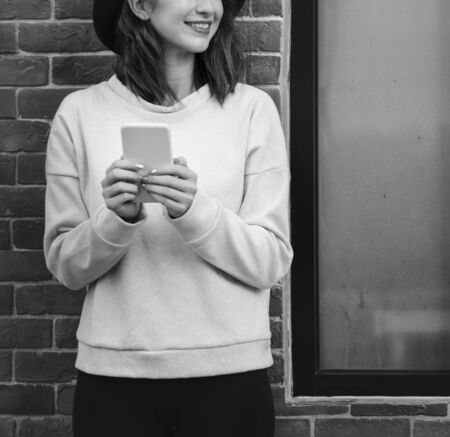 techie: Woman Using Smart Phone Connection Techie Stock Photo