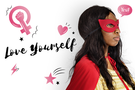 Love yourself concept with woman in superhero costume