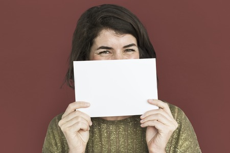 Woman holding a copy space placard Stock Photo