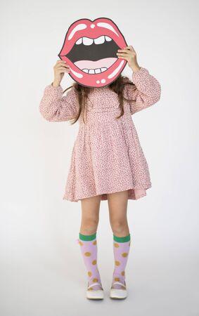 papercraft: Little Girl Holding Papercraft Arts Smiling Mouth Studio Portrait