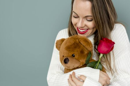 Young Lady Hugging Teddy Rose Smiling Stock Photo