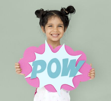 Little GIrl Smiling Happiness Playful Pow Comic Speech Bubble Stock Photo